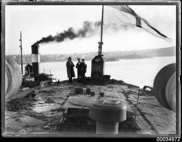 HMAS Australia being towed to her doom in 1924. Courtesy ANMM Collection