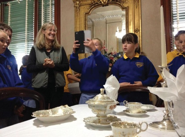 History in Place in action: Trudi Toyne, manager of Barwon Park, shows school students around the heritage property. Courtesy of Culture Victoria.