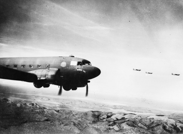Transport planes flying towards Wau. Courtesy Australian War Memorial.  AWM,  ID 014412.