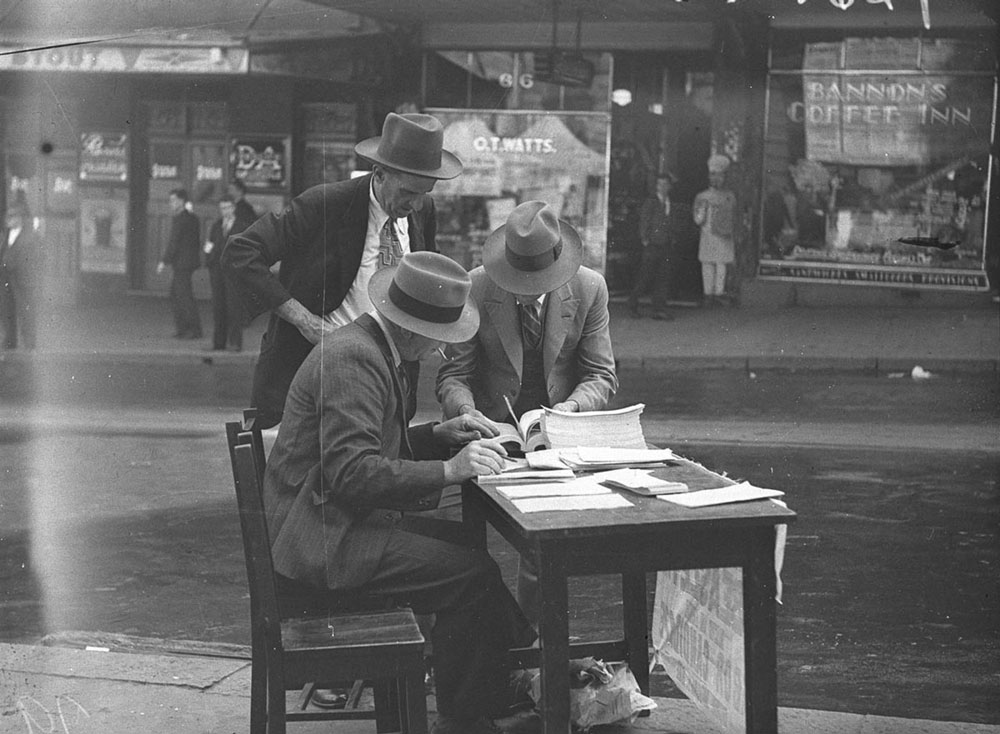 Expert consultation. Photographed by Sam Hood, 1937. Courtesy State Library of NSW.