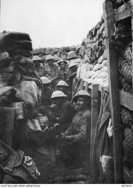 Men of the 53rd Battalion waiting to don their equipment for the attack at Fromelles. Only three of the men shown here came survived, all three wounded. Courtesy Australian War Memorial, ID A03042.