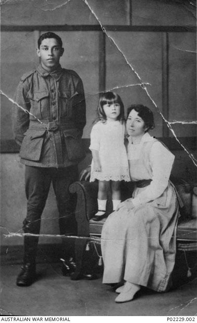 Grafton, NSW. c. 1917-11. Studio portrait of Private Harold Arthur Cowan, his cousin Hazel Williams and her baby sister, c.1917. Courtesy Australian War Memorial, ID P02229.002