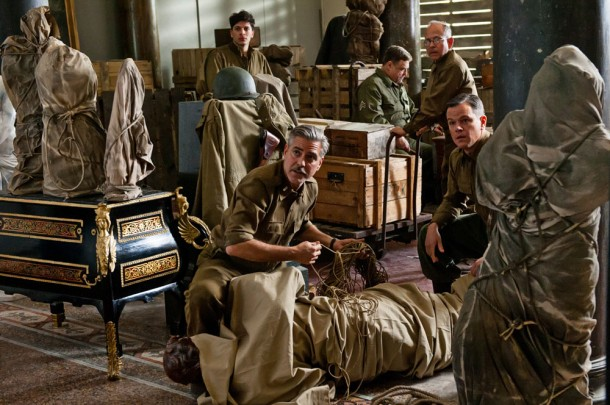 George Clooney in character as Frank Stout on the set of Monuments Men. Courtesy Twentieth Century Fox.