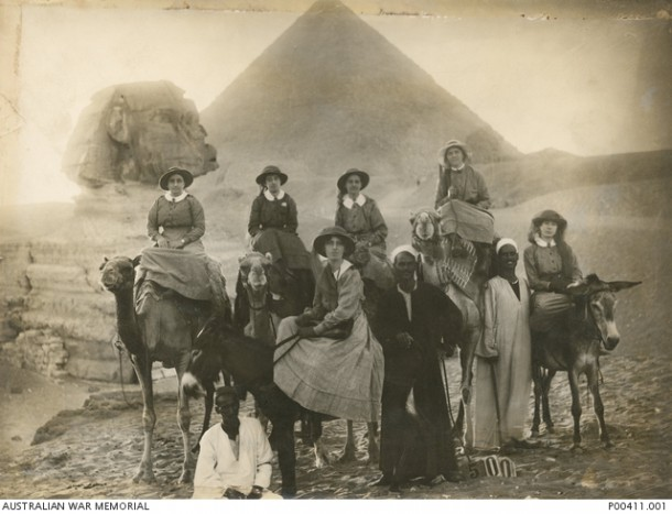 Members of the Australian Army Nursing Service, pictured on camels in front of the Sphinx and pyramids. Sister Isabelle Bowman is believed to be one of the nurses. Courtesy Australian War Memorial, P00411.001