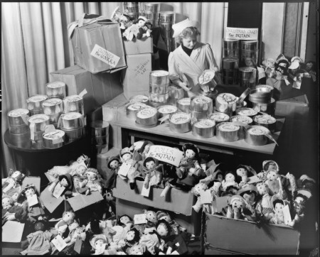 Woman with cakes and dolls on display for the war effort. Curtesy State Library Victoria H2011.52/287