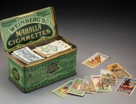Tobacco tin containing cigarette cards collected by Alice Eaton (née Yoxon). Image courtesy National Museum of Australia and Jason McCarthy.