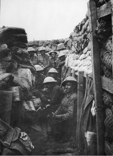 Men of the 53rd Battalion waiting to don their equipment for the attack at Fromelles. Only three of the men shown here came out of the action alive, and those three were wounded. Courtesy AWM.