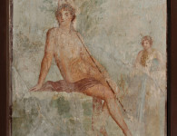 A fresco from Pompeii illustrating a story from mythology – Narcissus admiring his reflection, while in the background Echo pines away with unrequited love. Courtesy Ministero dei Beni Culturali e del Turismo – Museo Archeologico di Napoli.