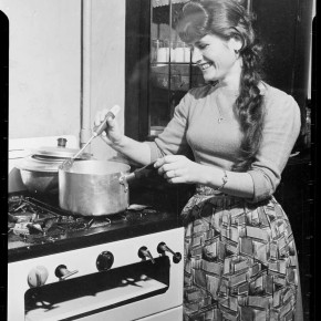 Vassiliki Daflou demonstrates the modern convenience of a gas stove – as the face of a promotional campaign to attract Greek women to Australia in 1962. Courtesy NAA: A12111, 1/1962/4/44.