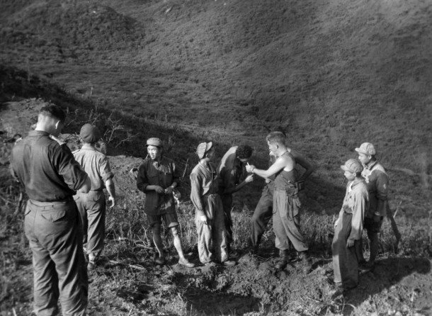 Diggers from the 2nd Battalion Royal Australian Regiment, mingled with Chinese soldiers in no man's land the morning after the Cease Fire in Korea, c.1953. Courtesy SLV, ID H2002.199/4394.
