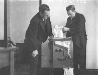 Commonwealth Bank Officials testing a new coin counting and sorting machine c. 1930. Image courtesy of State Library of New South Wales:FL1290598